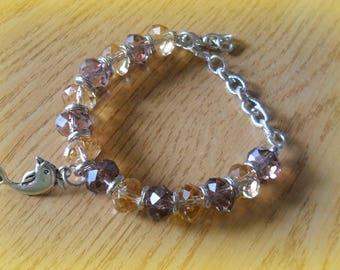 Transparent pink and purple bracelet with pendant