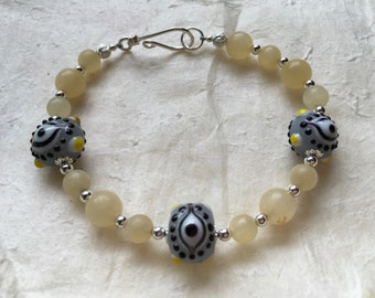 Yellow Jade and Eye Bead Bracelet