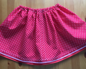 Red and white spotted toddlers drawstring skirt.