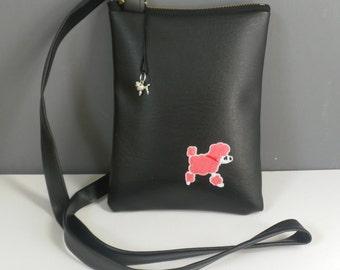 Black vinyl bag with Pink poodle motif.