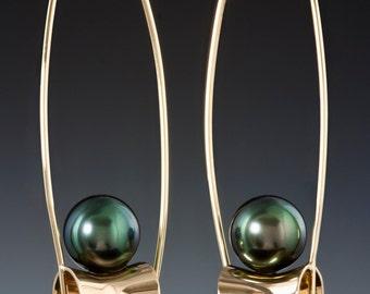 Lightweight, 14K Gold locking earring with Black Tahitian pearl.