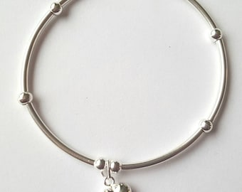 Sterling Silver noodle bead stretch bracelet with puffed heart charm.  Mothers day birthday, stacker bracelet
