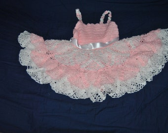 Pink and white dress with Ruffles and straps