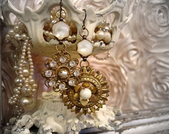 pUre as the driven snow one of a kind vintage assemblage earrings . antique mother of pearl buttons + asymmetrical vintage dangles