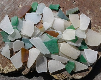 60 sea glass pieces 0.5''- 1.7''[1.3-4.3cm]. Genuine natural beach glass. Surf tumbled colored glass for various crafts and decoration.