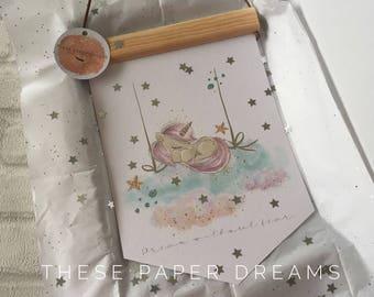 Wall Hanging whimsical unicorn decor, handmade, digital design, nursery decor, rainbow unicorn, sleepy unicorn, cloud swing, magical stars.