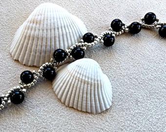 handmade black and silver serpentine bracelet