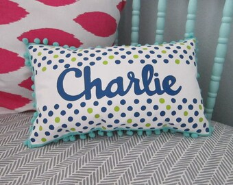 Pillow in navy and chartreuse polka dots. Personalized with name.