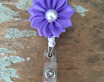 Pearl centered satin pinwheel flower ID badge reel holder retractable clip