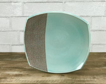 Large squared porcelain dinner plate with aquamarine glaze and knit pattern