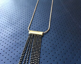 SEDUCTIVE Black and Gold Tassel Necklace on Gold Snake Chain
