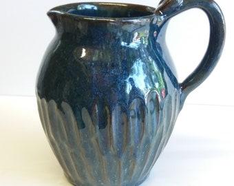 dark blue pitcher, carved