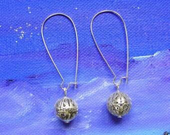 Elongated hoop earrings