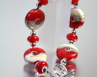 Sterling silver and lampwork bead red bracelet from the Coast to coast range by Helen Gorick