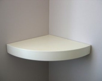 Floating corner shelf 36 mm thick with  primer coat finish .