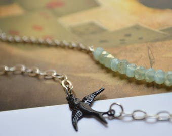 Green swallow and pearls bracelet duo of water