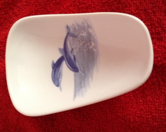 """Ceramic Spoon Rest with Dolphins on it.  5"""" Long and 3 1/2 Inches Wide at Top of Spoon"""