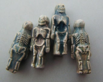 4 Tiny Raku Skeleton Beads - Cb570