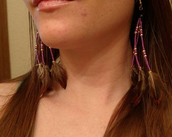 Long purple and gold feather earrings