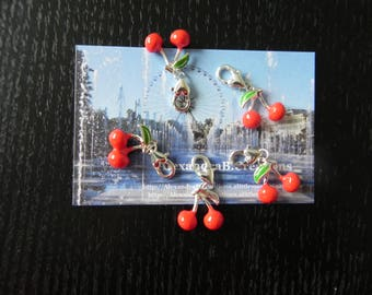 5 charms depicting enameled cherries