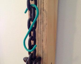 Modern coat hanger.  Chain + Laminate