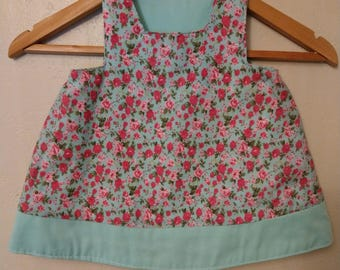 Reversible child's dress. Pink flowers and mint green.