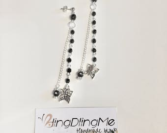 Pendant earrings with charm