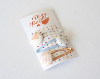 Pack of hair clips, made from repurposed fabrics. Pack of three white and peach hairclips, from recycled fabrics.