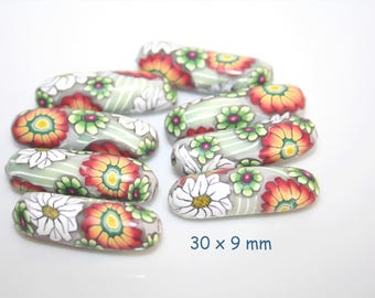 Curved polymer tube beads floral Orange-white-green / set of 8