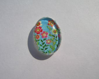 Cabochon 18 X 13 mm oval with a geometric image