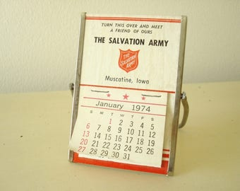 Salvation Army desk calendar, Muscatine Iowa, 1974 advertising premium, paper & steel, mirrored back, birthday for 1974 babies