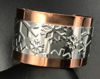 Copper cuff with sterling snowflakes