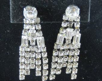 "Beautiful Vintage Rhinestone Clip On Earrings. 2"" Long. Stunning! Round clear rhinestones with emerald cut rhinestones. No Missing Stones."