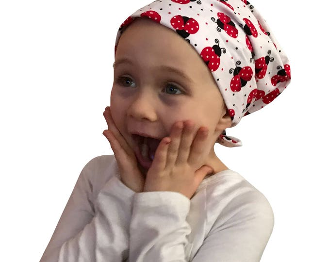 Featured listing image: Mia Children's Head Cover, Girl's Cancer Hat, Chemo Scarf, Alopecia Headwear, Head Wrap, Cancer Gift for Hair Loss - Large Ladybugs