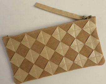 Pearly ivory leather zip pouch. Repurposed pearly diamond chips on beige suede, brass zipper, fully lined.