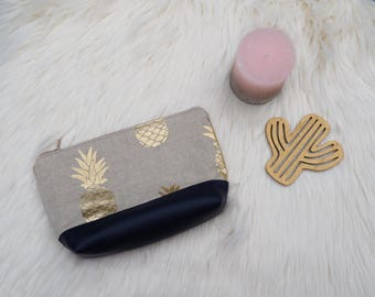 Golden pineapple patterned pouch.