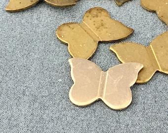 Ten small brass butterfly stampings
