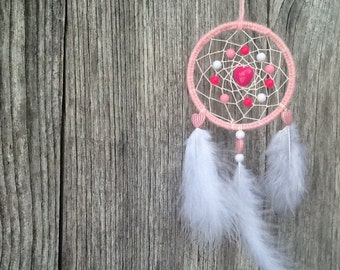 Dream catcher is hand 7 cm in diameter or 2.7 inches
