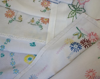 collection of  vintage hand embroidered flower mats