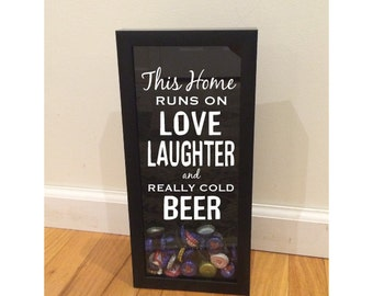 """Bottle Cap Holder Shadow Box - This Home Runs on Love, Laughter & Beer - Black (6"""" x 14"""") - Vinyl Decal Gifts, Home Bar Accessories"""