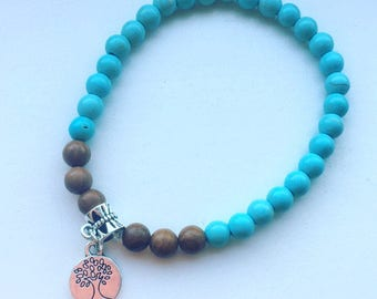 Blue turquoise magnesite and natural polish wood tree of life stretch bracelet