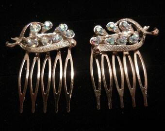 small silver hair comb with sparkly blue stones