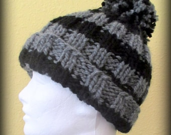Black and gray striped hand knit pom pom hat