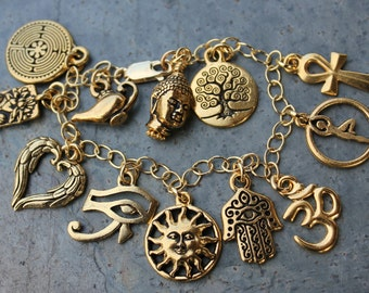 Deluxe Gold Ancient Religions Charm Bracelet - Eye of Ra, Angel Wings, Sun, Hamsa Hand, Yoga, Celtic tree of life, Buddha, Om, Ankh