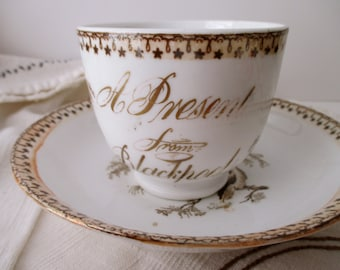 antique Blackpool souvenir CUP AND SAUCER - birds, England, seaside, gold