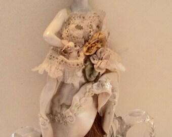 Vintage porcelain half doll with brown brush end