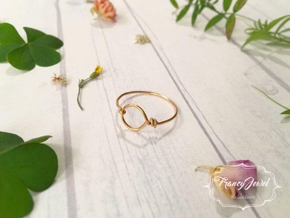 Karma, karma ring, gold ring, infinity ring, circle ring, handmade ring, made in Italy, brass jewelry, high quality, minimal ring