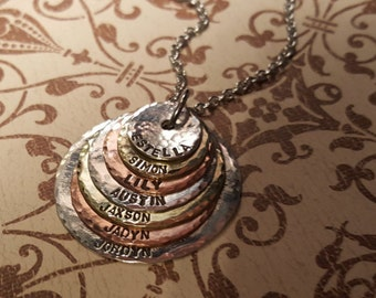 Mother..Grandmother necklace with 7 names...hand stamped mixed metal