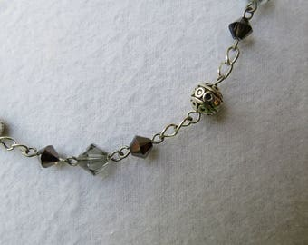 Grey and black crystal and antiqued filigreed silver beads necklace