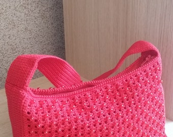 Crocheted bag with beads for a girl